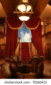 Interior of a local with theatrical curtains and stairs with a sky background. Location Barcelona, Spain.