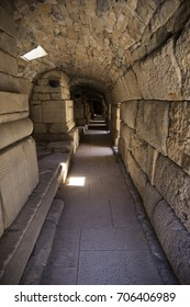 interior of a long corridor with a floor of large slabs of an ancient stone structure in the ancient city of Ephesus