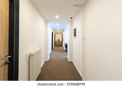 Interior of a long corridor in hotel apartment