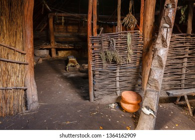 Interior of a longhouse with intertwined branch walls