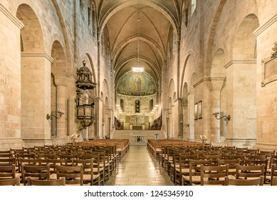 Interior of Lund cathedral with the nave, altar and  mosaic in soft light,  Lund, Sweden, November 16, 2018