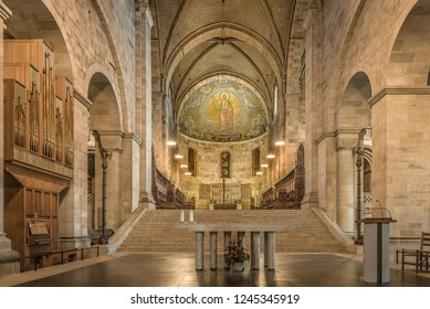 Interior of Lund cathedral with the sandstone, altar and the mosaic in soft light,  Lund, Sweden, November 16, 2018