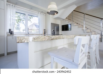 Interior of luxurious bright kitchen with marble worktop