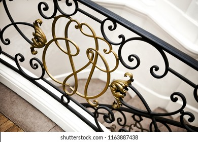 Interior of a luxurious French mansion and golden stair railing