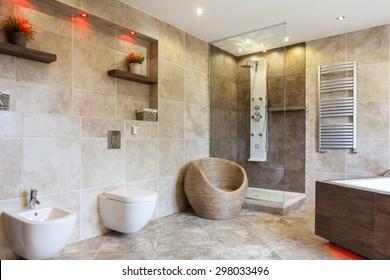 Interior of luxury bathroom with beige tiles