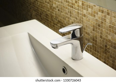 Interior of luxury bathroom with sink basin faucet.