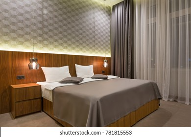 Interior of a luxury double bed hotel bedroom in the evening