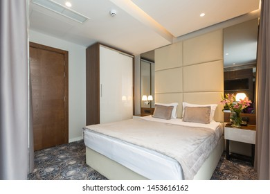 Interior of a luxury hotel double bed bedroom