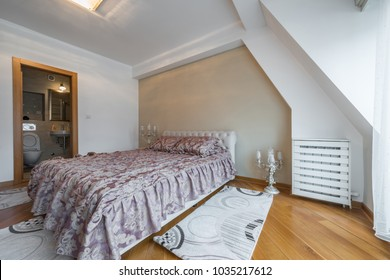 Interior of a luxury loft bedroom with master bed and bathroom