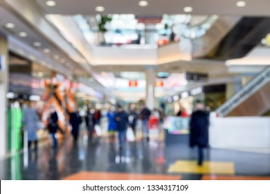Interior of luxury mall as creative abstract blur background. Panorama of a large shop or store. People are inside the shopping center. Concept of shop and retail, blur