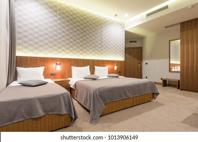 Interior of a luxury modern new hotel bedroom in the evening