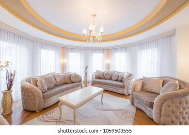 Interior of a luxury, open plan, living room with round, circle, ceiling