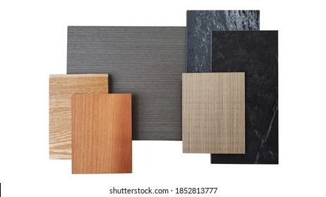 interior material board including brown laminated, oak engineer flooring, burnt sienna and douglas fir wooden veneer, black marble artificial stone isolated on white background with clipping path. - Shutterstock ID 1852813777