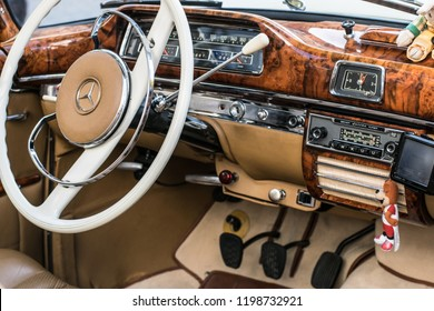 the interior of the Mercedes oldtimer in a beige and white color, covered with leather and wood, Pforzheim, Germany, 07.10.2018