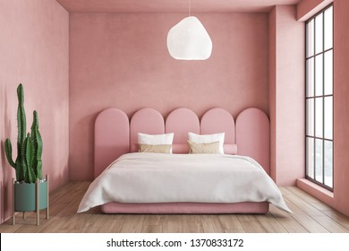 Interior of minimalistic bedroom with pink walls, wooden floor, master bed with original headboard and large window. 3d rendering
