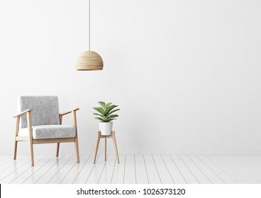 Interior mock up with gray velvet armchair, plant in pot, and hanging lamp in living room with white wall. 3D rendering.