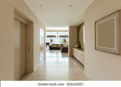 Interior of modern apartment , living room view from corridor