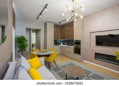Interior of a modern apartment, loft-style room, with beautiful furniture, living room combined with kitchen