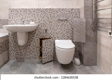 interior of modern bathroom with bath, shower and toilet, hidden communications.