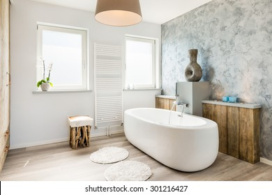 Interior of a modern bathroom with seperate bath