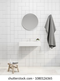 Interior of a modern bathroom with white tiled walls, a white floor and a sink with a round mirror hanging above it. 3d rendering mock up