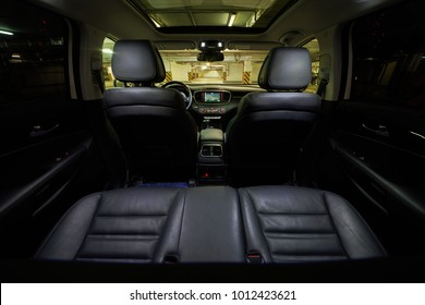 Interior of modern car cabin at underground parking.