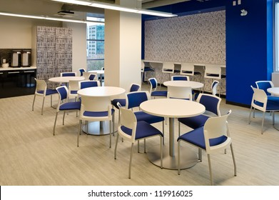 Interior of modern company lunchroom where employees can have their break.