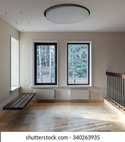 Interior of modern empty space with suspended bench and big windows