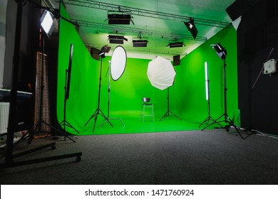 Interior of Modern Film Chroma Key Studio with Green Screen and Light Equipment