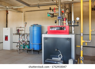 interior of a modern gas boiler room, with a water treatment system, many valves and sensors