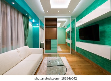 Interior of a modern green living room with luxury ceiling lights