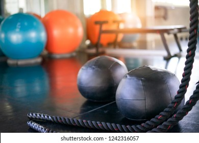 Interior of modern gym with equipment. Exercise back color ball in fitness, gym equipment and fitness balls in sports club.