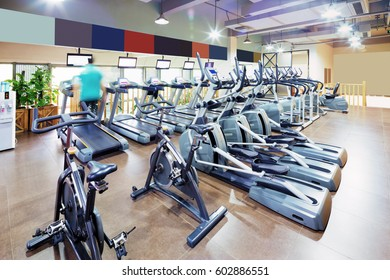 interior of modern gym with fitness equipment