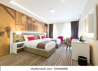 Interior Of A Modern Hotel Bedroom In The Morning
