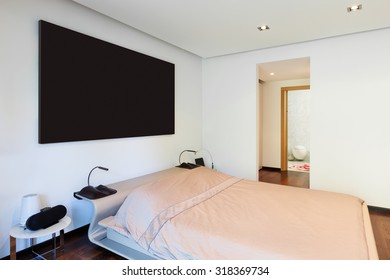 Interior of modern house, comfortable bedroom
