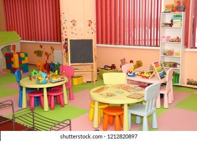 Interior of modern kids playing room in the kindergarten - children's entertainment, recreation, sports, educational games indoor