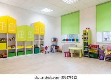 Interior of a modern kindergarten in yellow and green colors.