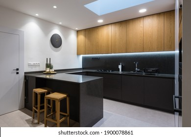 Interior of modern kitchen with built-in appliances in a house