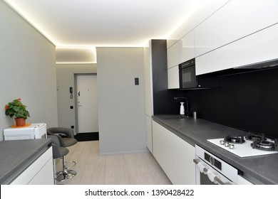 Interior of modern kitchen in gray-black tones