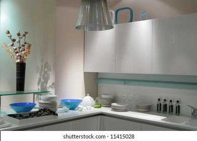 interior of modern kitchen in light tone with bouquet of cotton bud