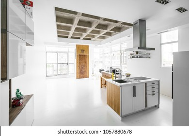 Interior of modern kitchen with unfinished ceiling