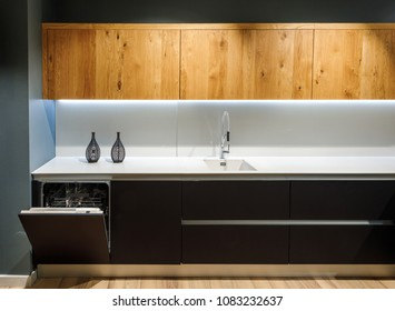Interior of modern kitchen with white counter