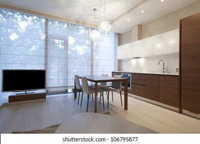 Interior of modern living room with kitchen