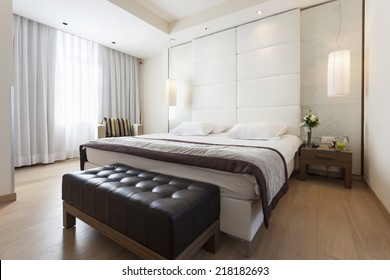 Interior of a modern luxury bedroom with bed bench