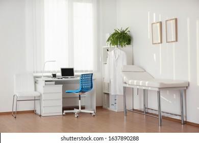Interior of modern medical office with doctor's workplace