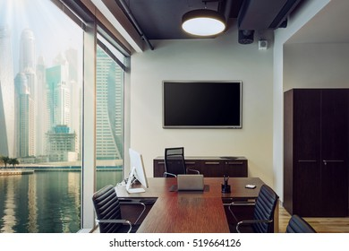 Interior modern meeting room with panoramic windows and with multiboard on the wall