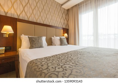 Interior of a modern new double bed hotel bedroom