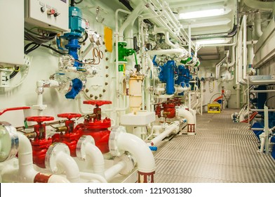 Interior of modern offshore vessel with complicated machinery, pumps, engines and valves