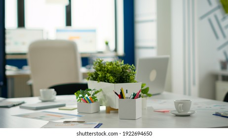 Interior of modern open plan financial office with no people, stylish room interior with meeting table and chairs. Business center with brainstorm area, shot of empty room with modern furniture.