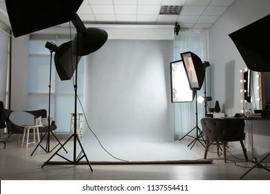 Interior of modern photo studio with professional equipment